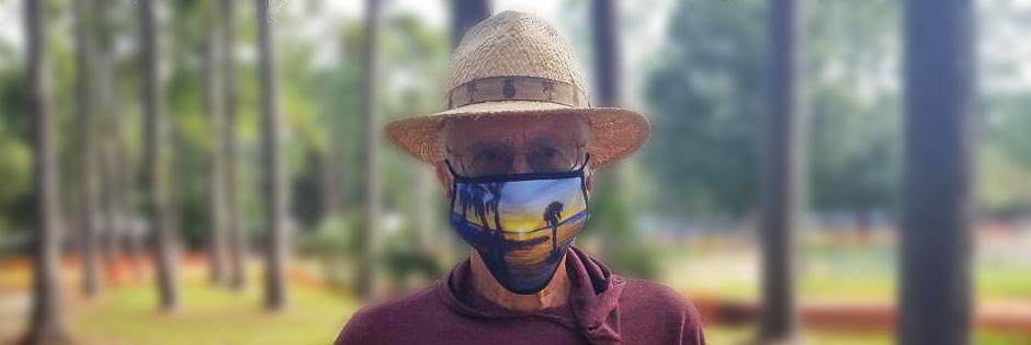Guy wearing Ernest Lee Art Print face mask